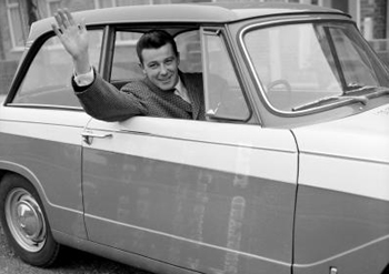 Johnny Byrne waves to his wife
